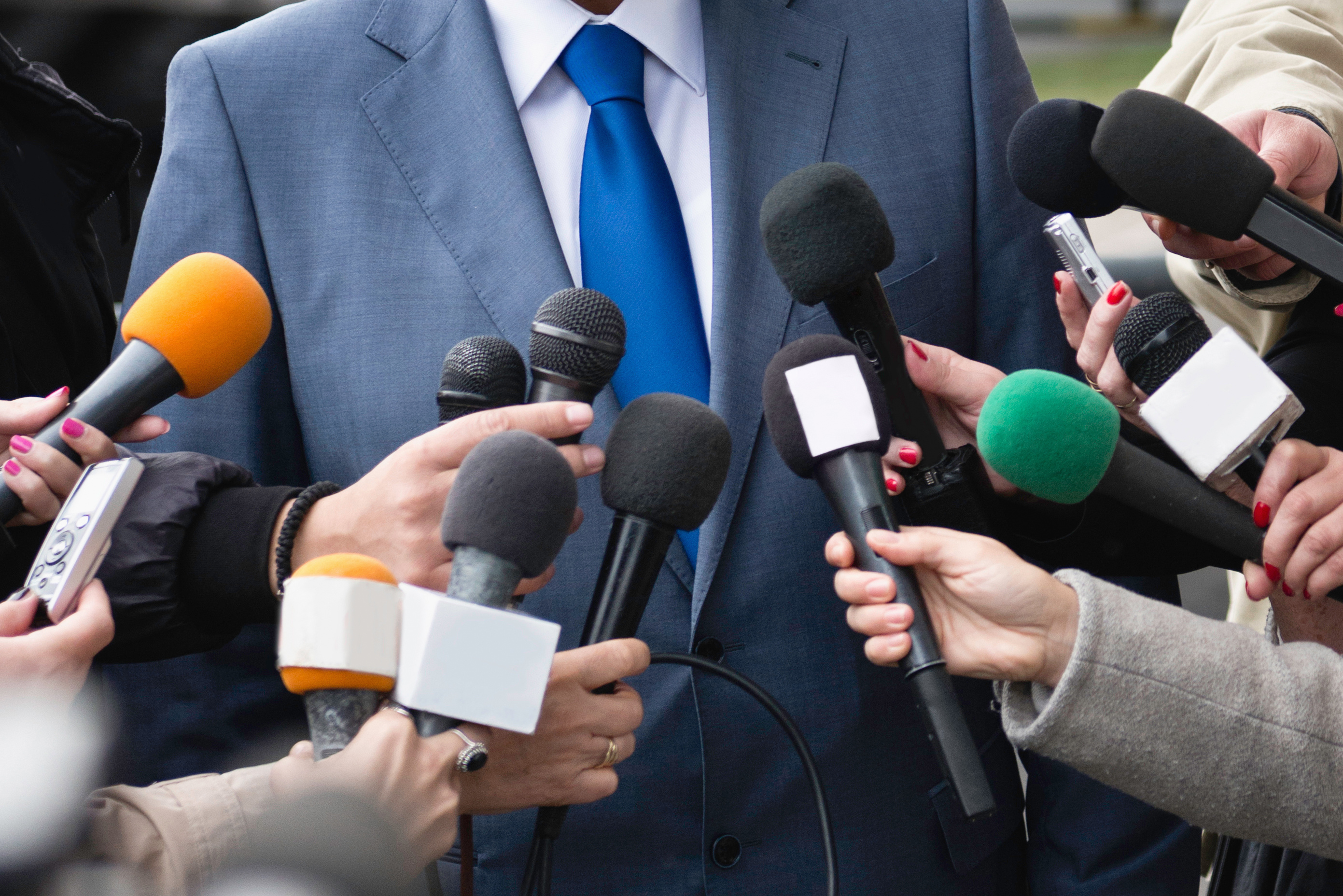 Politician answering media questions
