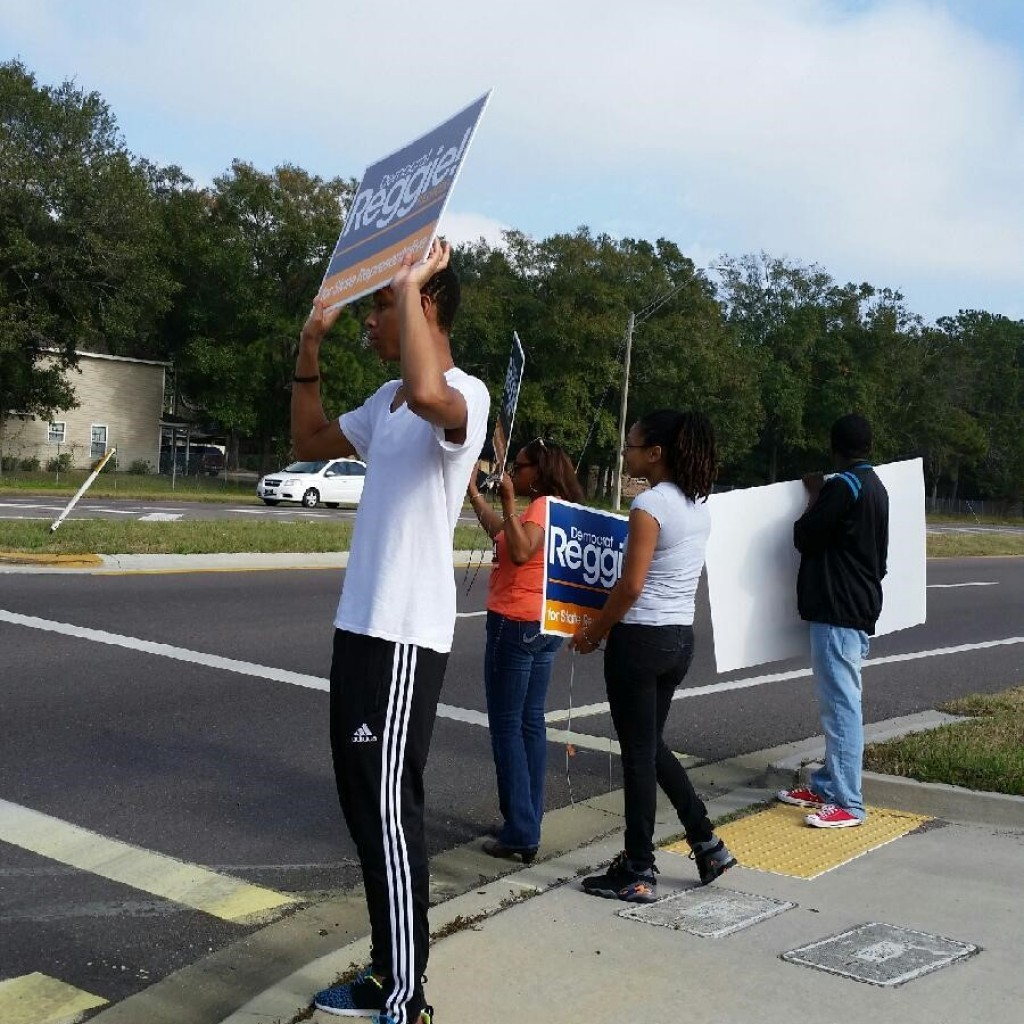 Supporters wave signs in support of Reggie Fullwood. (photo credit Amber Holland)