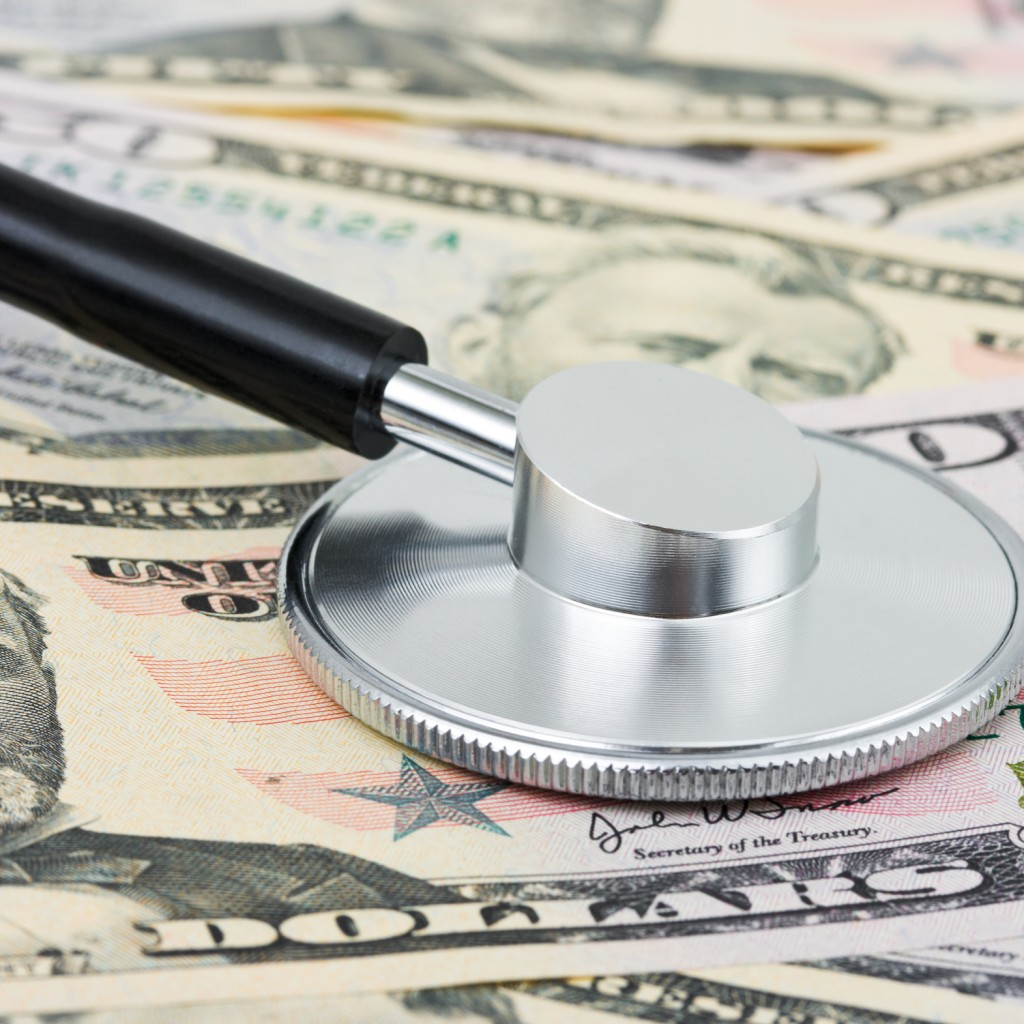 Stethoscope on money background