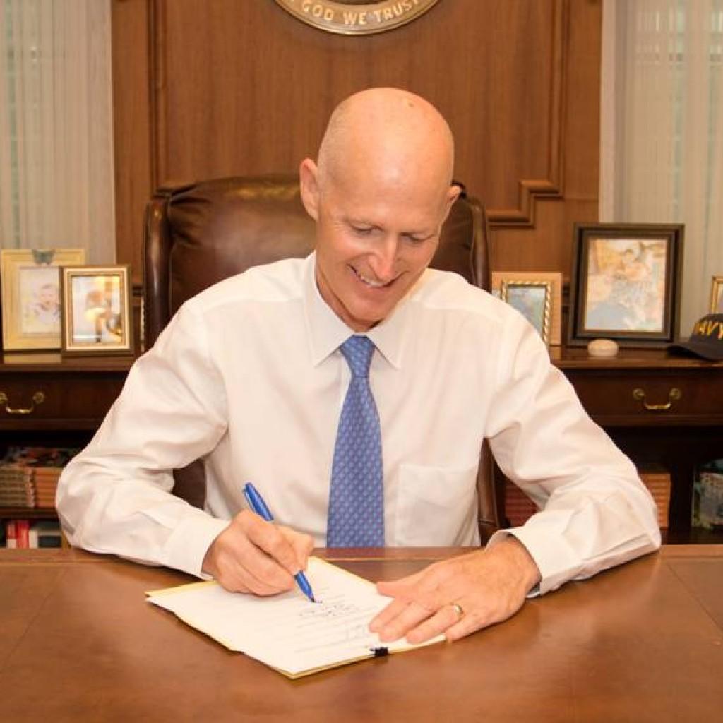 scott, rick - signing budget
