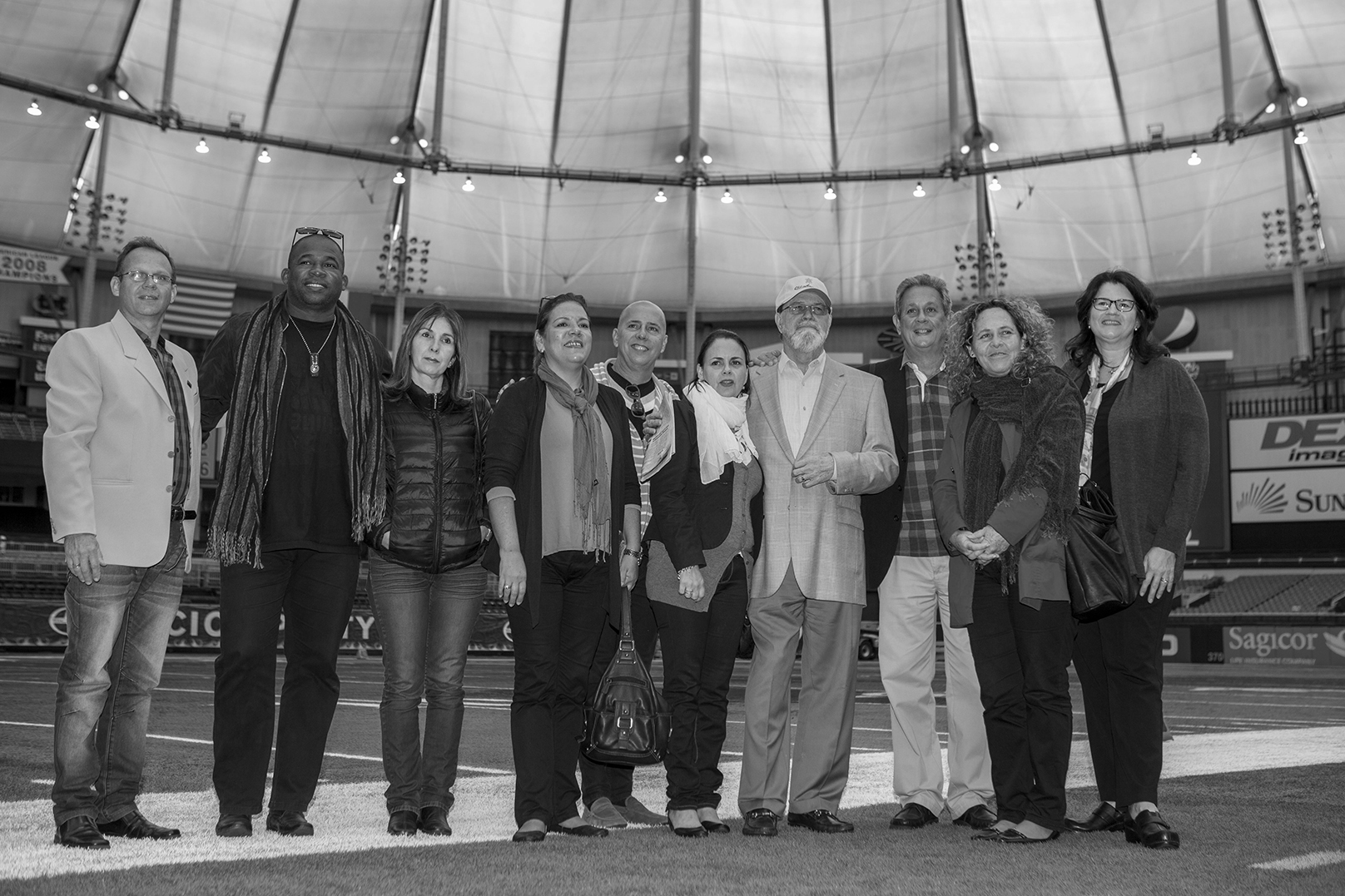 Members of a nine-person Cuban delegation hosted by the St. Petersburg Downtown Partnership and local city officials, spent three days touring St. Pete's museums, art programs and Tropicana Field. Left to right - Cuban artist Estaben Machado, Vilmaidy Bombale Laborde, Director of Communications and Events of the National council of Fine Arts; Sandra Fuentes Guevara, Director of Escuela Nacional de Bellas Artes; Marisol Peraza Simon, Director of Ministry of Culture - North America; Rafael Mendez Gonzalez, General Director Arte y Moda company; Rosa Teresa Rodriguez, Ministry of Culture Deputy Director; Albert A. Fox Jr. Founder and President of the Alliance for Responsible Cuba Policy Foudation; Alfredo Ruiz Roche, Director of Ministry of Culture and the Department of International Relations; Ana Cristina, Director of the National Fine Arts Museum in Cuba; Joni James, CEO of St. Petersburg Downtown Partnership.