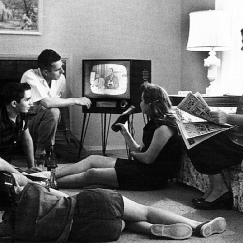 the-eye-of-faith-on-tv-vintage-photo-of-family-watching-television-1958-e1449522032614-1024x1024.jpg