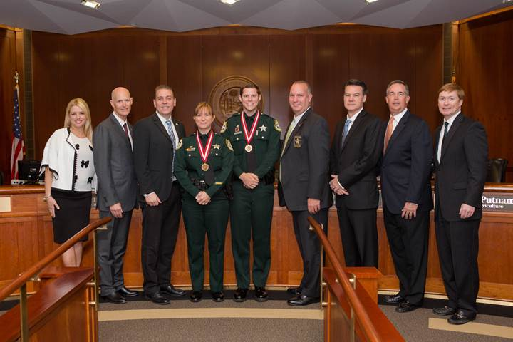 Gov. Rick Scott and the Florida Cabinet with the Medal of Heroism recipients. Courtesy of Governor's Office.