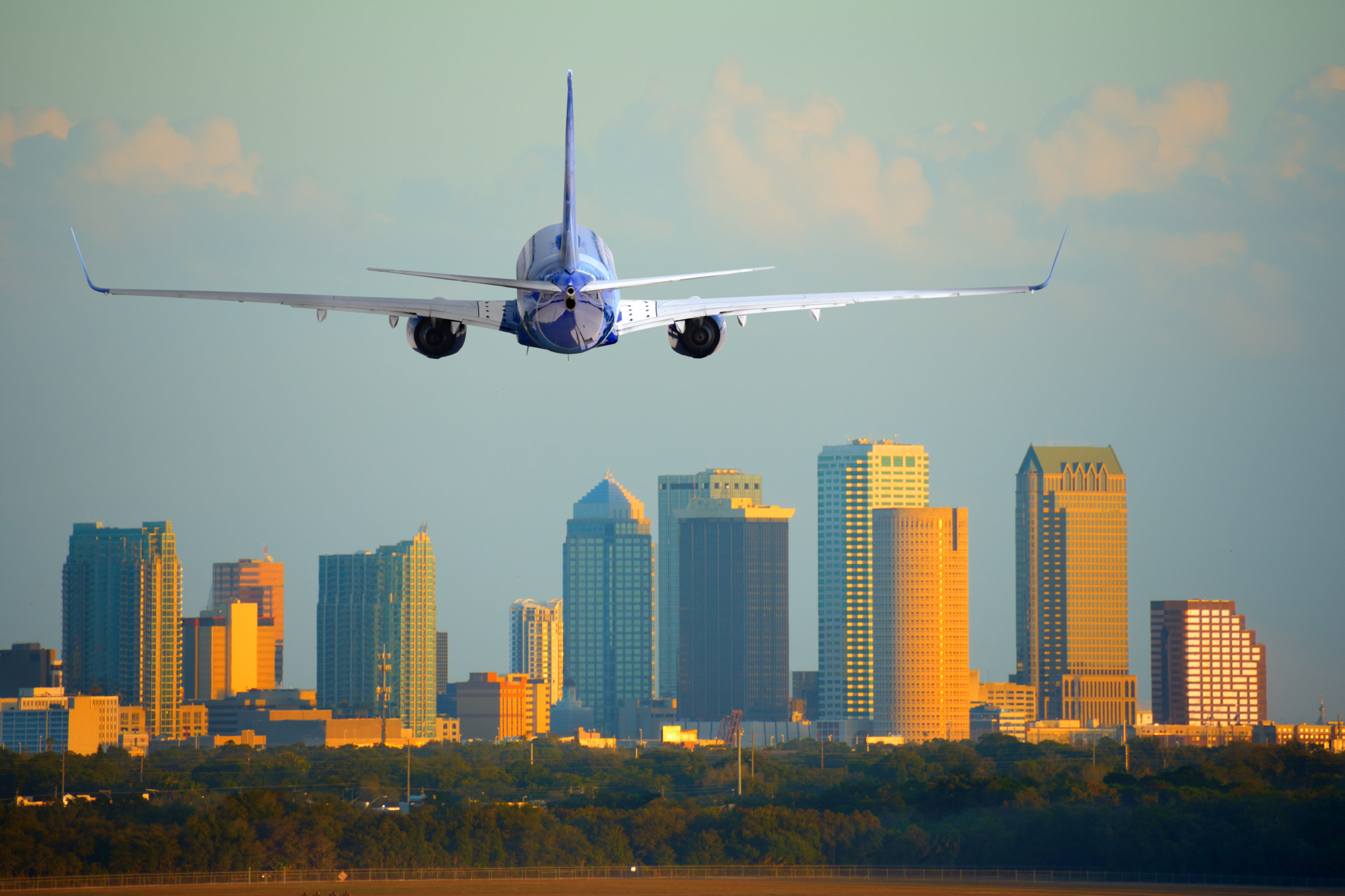Passenger jet airliner plane arriving or departing Tampa International Airport in Florida at sunset or sunrise