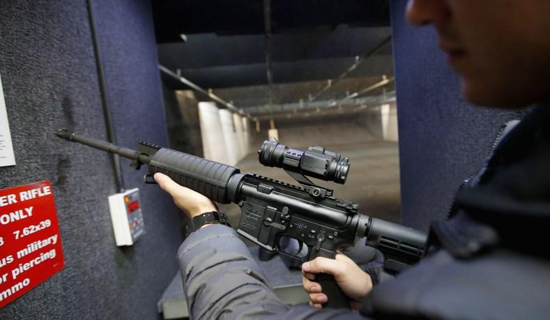 Alec Murrary holds an AR-15 assault rifle at the Ringmasters of Utah gun range