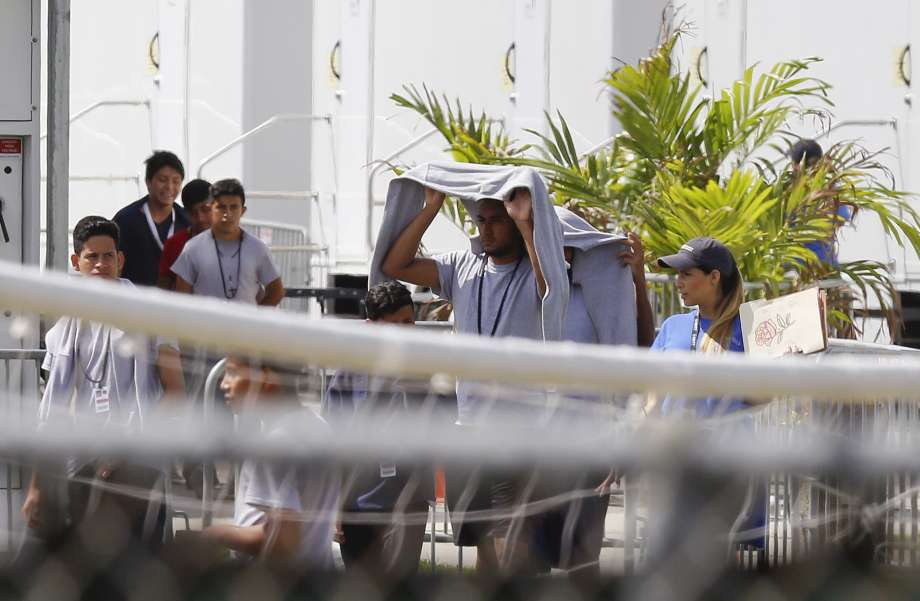 Migrant children walk outside at the Homestead Temporary Shelter for Unaccompanied Children