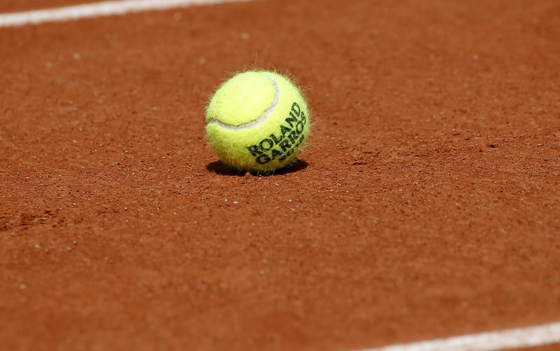 AP Photo - Tennis ball on court