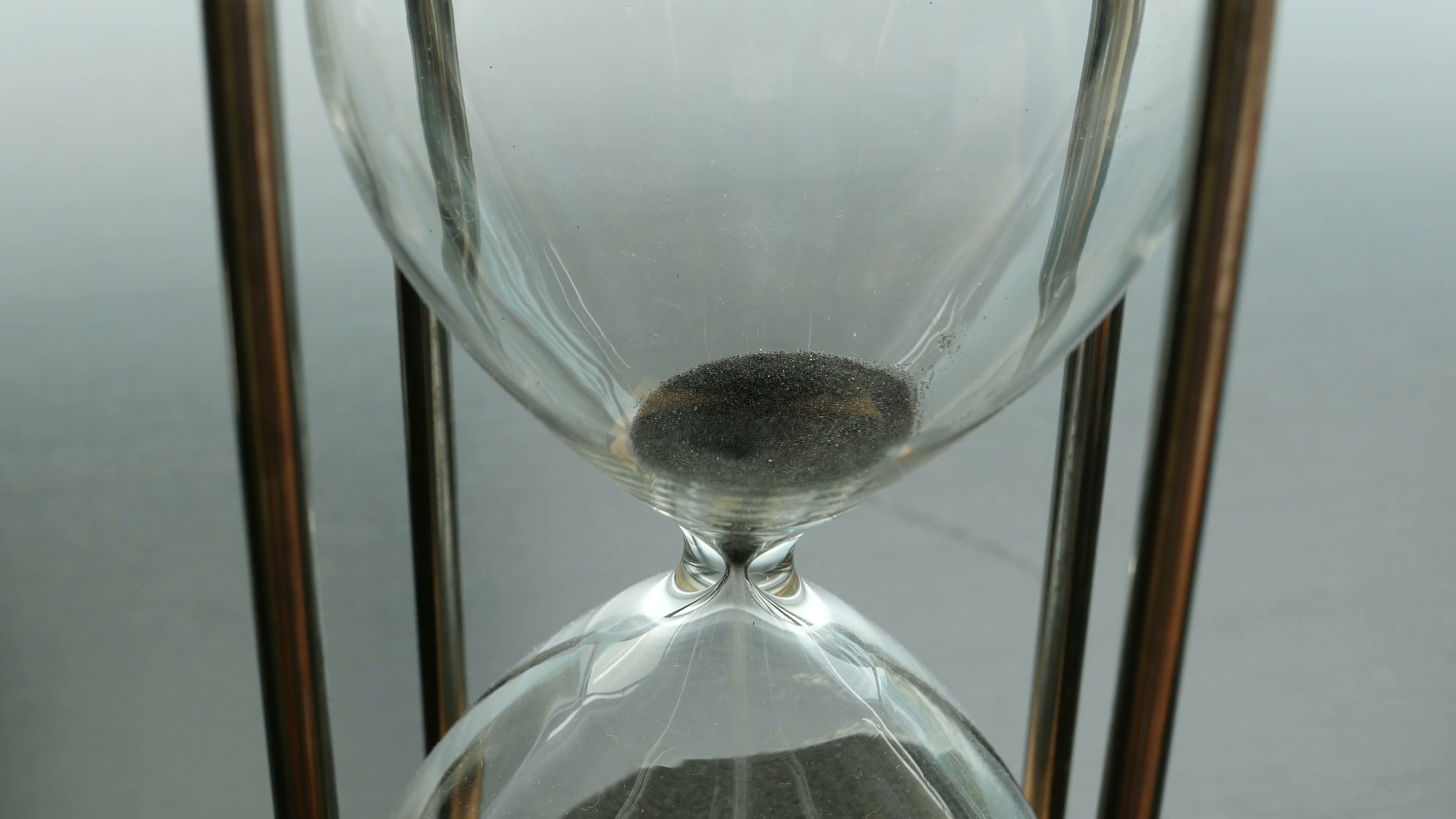 hourglass-black-sand-time-runs-out-the-upper-portion-of-an-hourglass-with-black-sand-time-running-out-concept_ejzawl0t__F0000-3500x1969.png