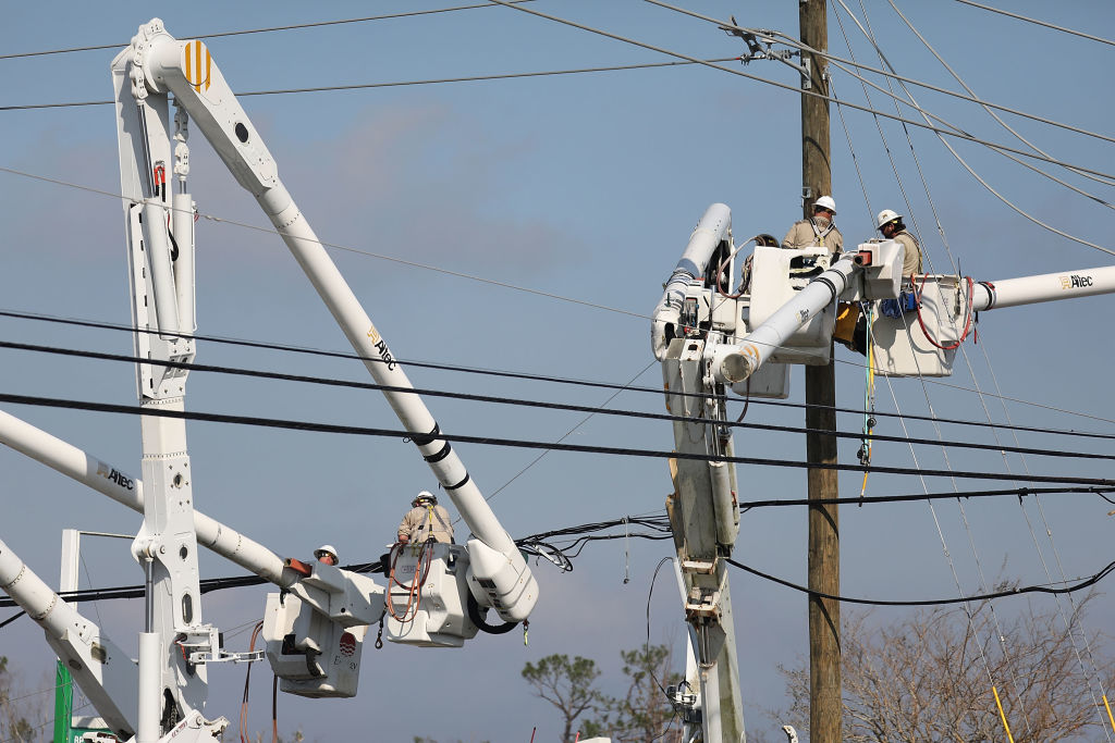 line workers working to restore power after a natural disaster