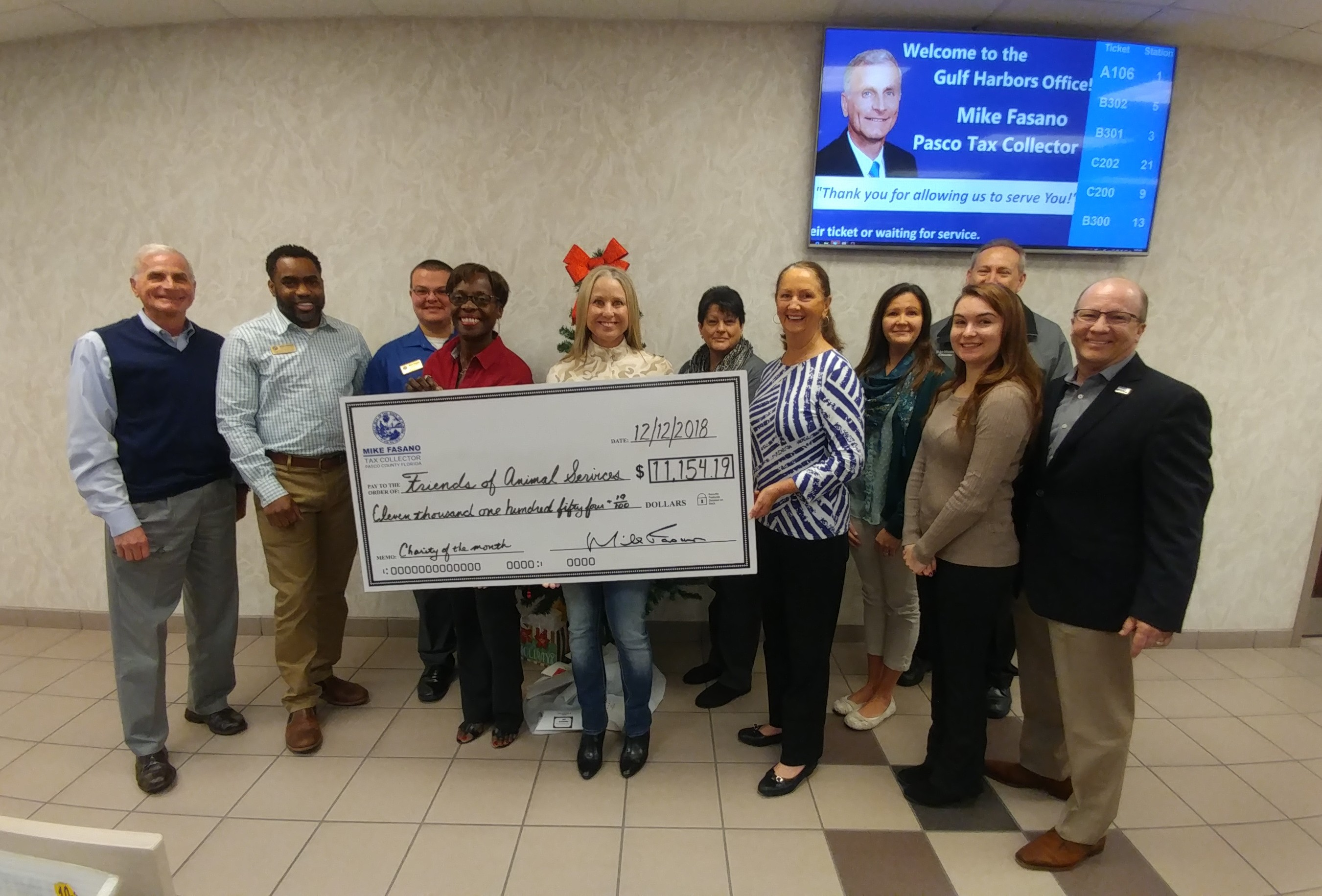 from left to right – Tax Collector Mike Fasano; Supervisor Carlton Francis; Customer Service Representative Tyler Albritton; Assistant Manager Harriette Sorezza; Abby Cox, Friends of Animal Services; Supervisor Janice Reda; Darlene Green, Friends of Animal Services; Supervisor Mikala Ballard; Customer Service Representative Lauren Mazzone; Mike Shumate, Manager of Pasco Animal Services & Michael Cox, Friends of Animal Services.