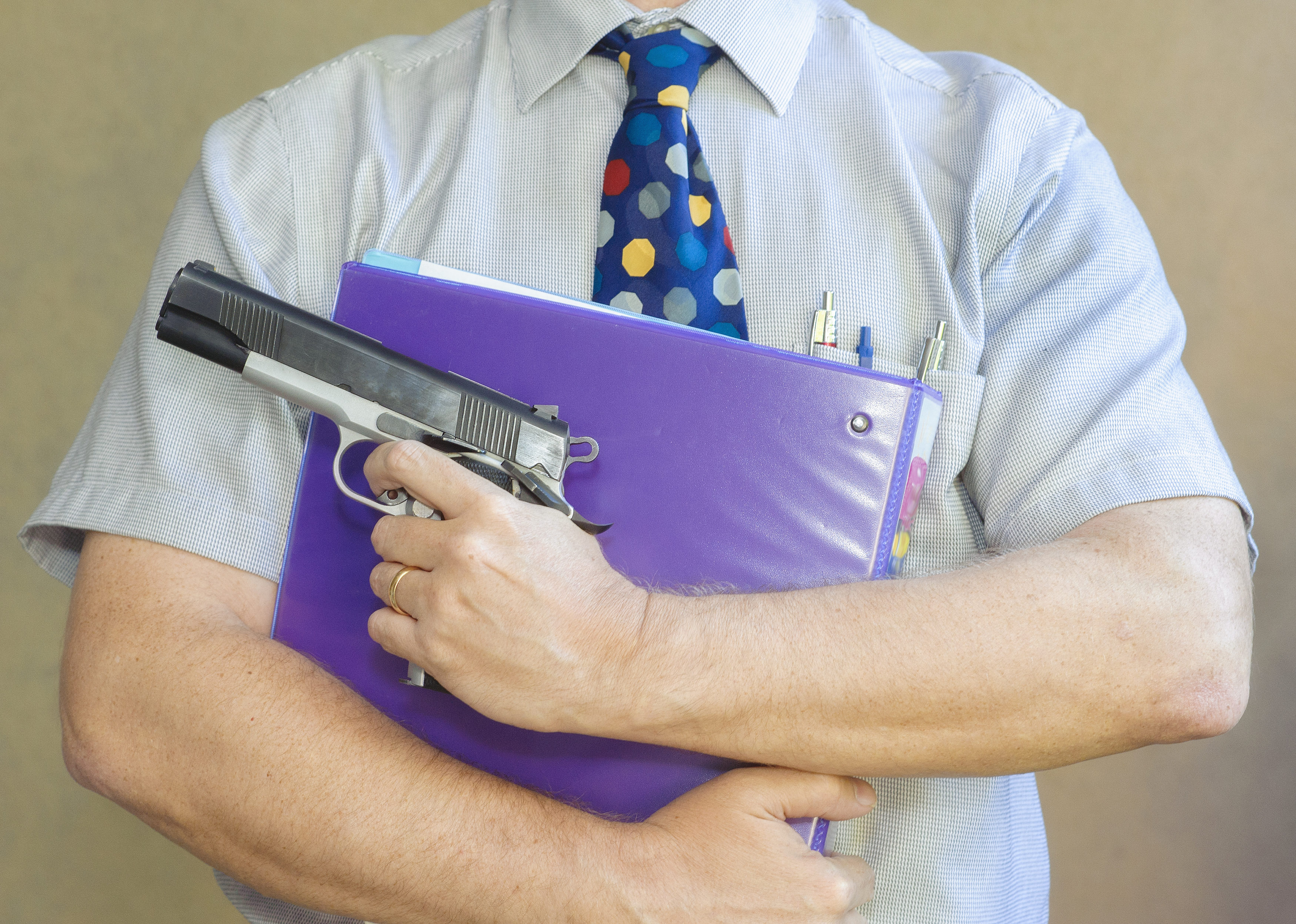 teacher-with-gun-3500x2495.jpeg