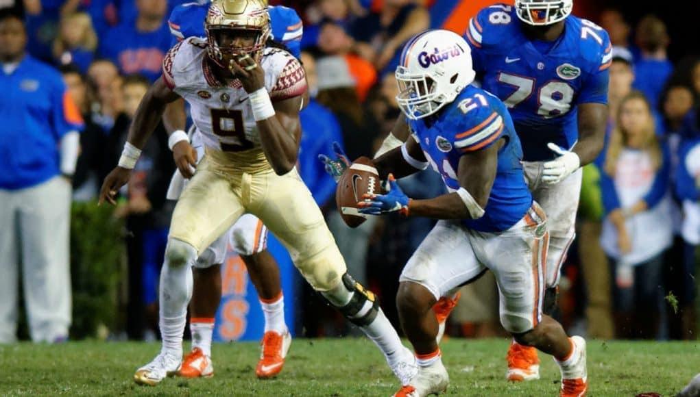 Florida-Gators-running-back-Kelvin-Taylor-runs-against-FSU-in-2015-1021x580.jpg