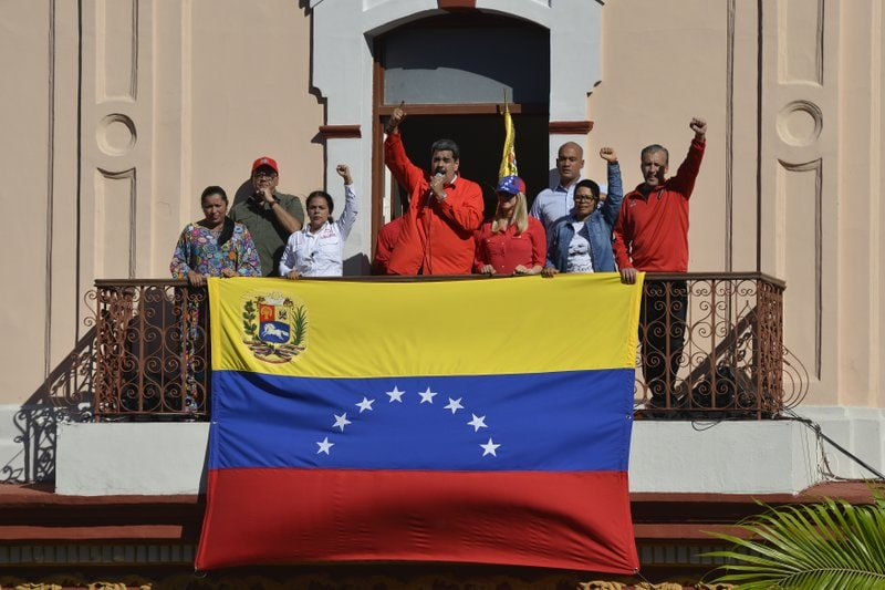 Venezuelan President Nicolas Maduro speaks to supporters from a balcony at Miraflores presidential palace during a rally marking the anniversary of the coup that overthrew dictator Marcos Perez Jimenez in 1958, in Caracas, Venezuela, Thursday, Jan. 23, 2020. (AP Photo/Matias Delacroix)