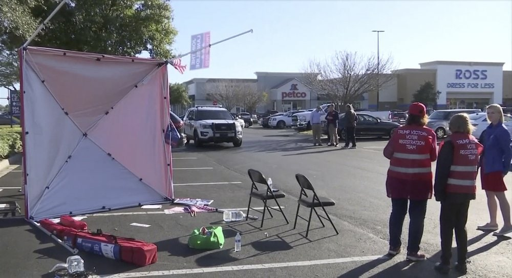 In this Saturday, Feb. 8, 2020, image taken from video a voter registration tent lays on its side after Gregory Timm drove a van through it, in Jacksonville, Fla. The Jacksonville Sheriff's Office said Sunday, Feb. 9, Timm was arrested in the incident. (WJXT News4Jax via AP)