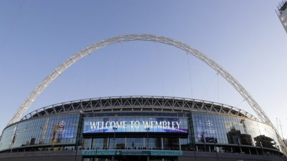 "FILE - This Oct. 3, 2018 file photo shows a view of the exterior of Wembley Stadium in London. The Jacksonville Jaguars will play two home games in London next season, strengthening the franchise's foothold in an overseas market the NFL is eager to expand. The Jaguars will play back-to-back games at historic Wembley Stadium, giving them a potential ""home-field"" advantage in the second one since they won't have to travel that week. Specific dates were not announced.(AP Photo/Kirsty Wigglesworth, File)"