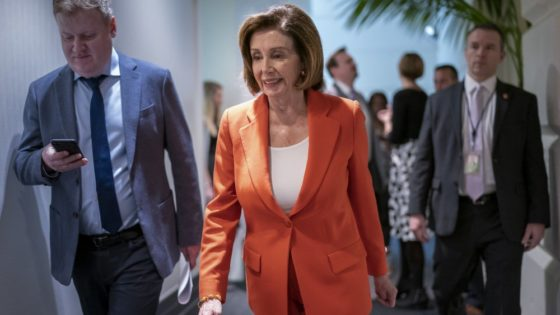 Speaker of the House Nancy Pelosi, D-Calif., arrives for a meeting with fellow Democrats on Capitol Hill in Washington, Wednesday, Feb. 26, 2020. (AP Photo/J. Scott Applewhite)