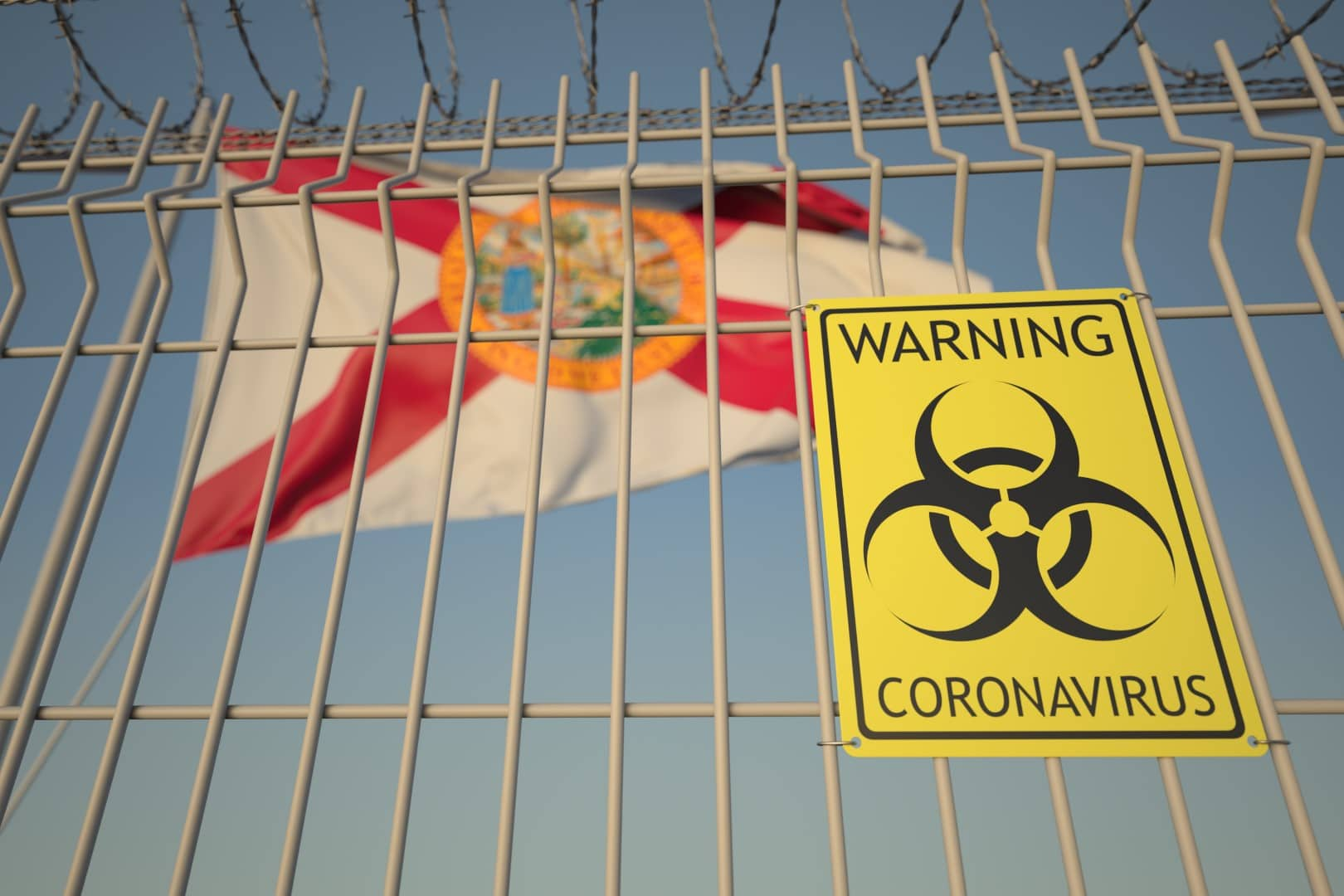 Coronavirus warning sign on the barbed wire fence against flag of Florida. COVID-19 quarantine related 3D rendering