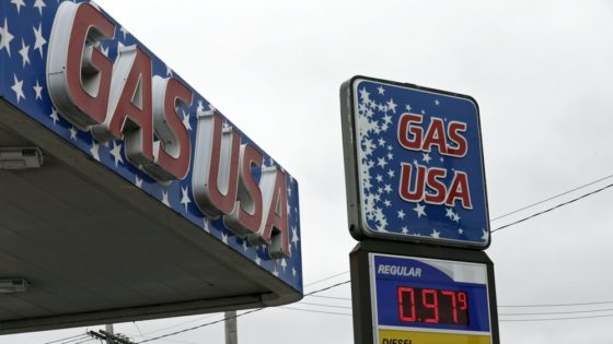 Gas USA is selling gas for 97.9 cents a gallon, Monday, March 30, 2020, in Cleveland. Oil started the year above $60 and has plunged on expectations that a weakened economy will burn less fuel. The world is awash in oil, meanwhile, as producers continue to pull more of it out of the ground. (AP Photo/Tony Dejak)