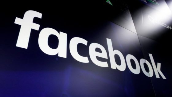 This March 29, 2018, file photo shows the Facebook logo on screens at the Nasdaq MarketSite, in New York's Times Square. Facebook, Google and other platforms are taking unprecedented steps to protect public health as potentially dangerous coronavirus misinformation spreads around the world. In a possible first, Facebook removed a post by Brazilian president Jair Bolsonaro that touted unproven viral benefits of a malaria drug, while Twitter nixed an associated video. (AP Photo/Richard Drew, File)