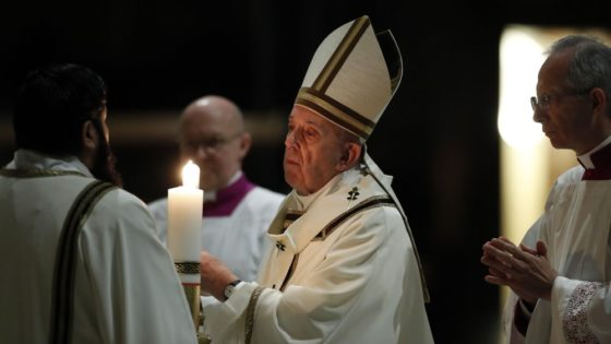 Pope Francis presides over a solemn Easter vigil ceremony in St. Peter's Basilica empty of the faithful following Italy's ban on gatherings to contain coronavirus contagion, at the Vatican, Saturday, April 11, 2020. The new coronavirus causes mild or moderate symptoms for most people, but for some, especially older adults and people with existing health problems, it can cause more severe illness or death. (Remo Casilli/Pool Photo via AP)