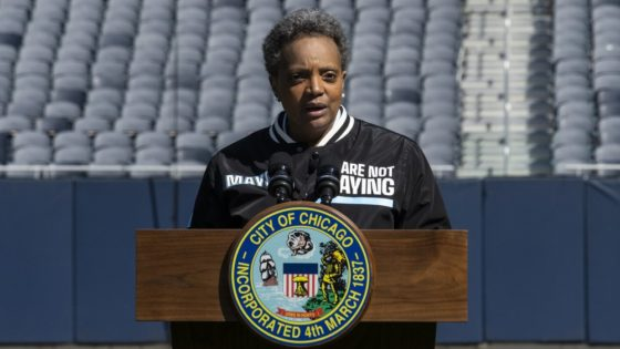 "Mayor Lori Lightfoot announces the ""We Are Not Playing"" campaign during a press conference at Soldier Field, Monday morning, April 6, 2020, in Chicago. The city is launching a health campaign focused on the city's black and brown communities, following a media report highlighting the disproportionate number of black residents among those who have died of COVID-19 complications in the city. (Ashlee Rezin Garcia/Chicago Sun-Times via AP)"