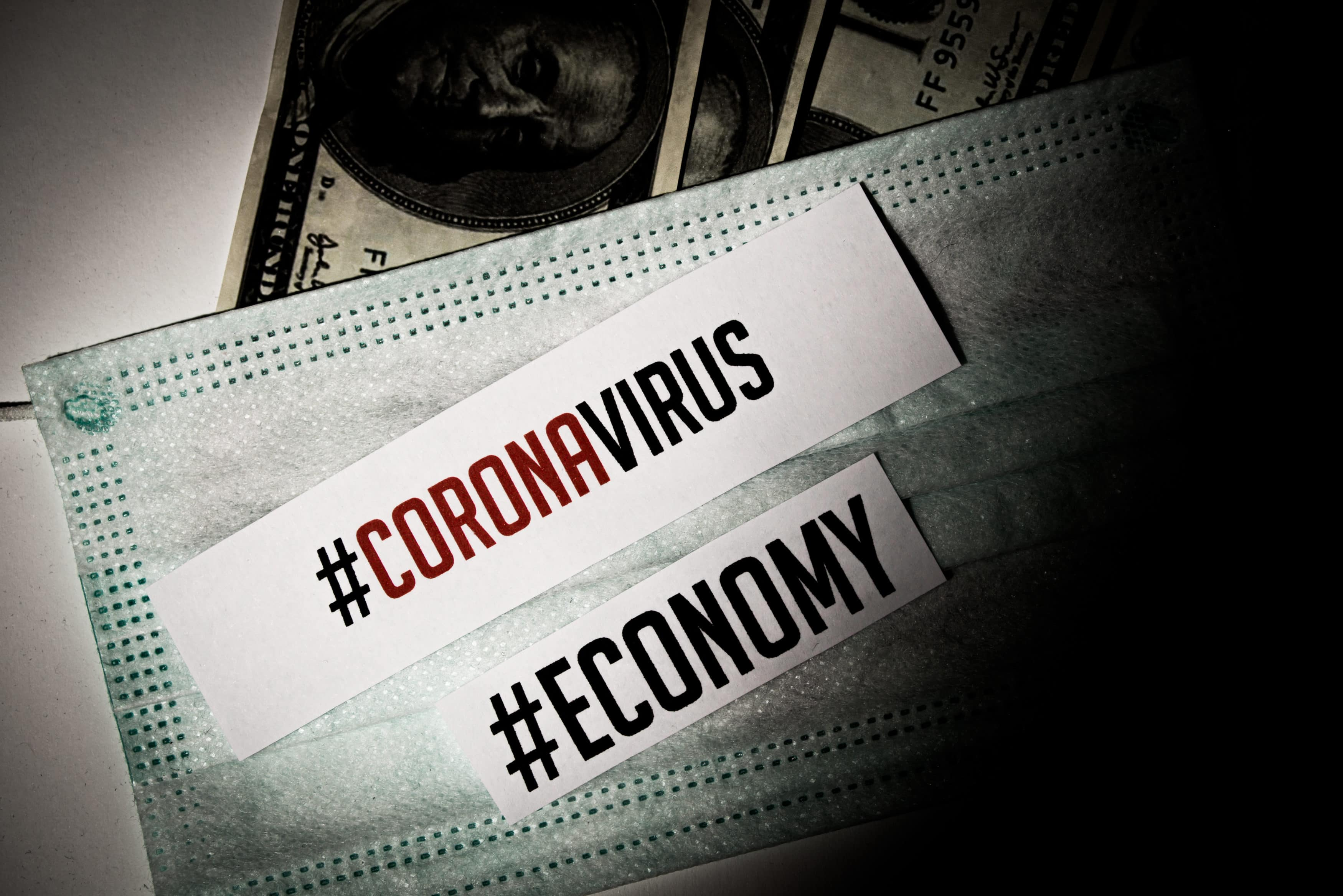 Corona virus impact on American economy and European economy crisis concept, banknotes with medical mask