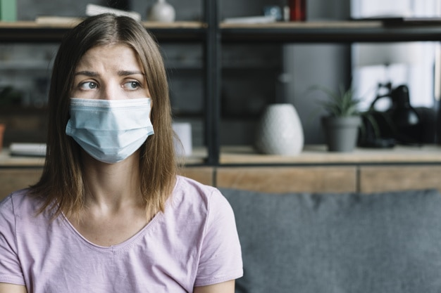 sick-woman-wearing-protective-mask-home_23-2147953259