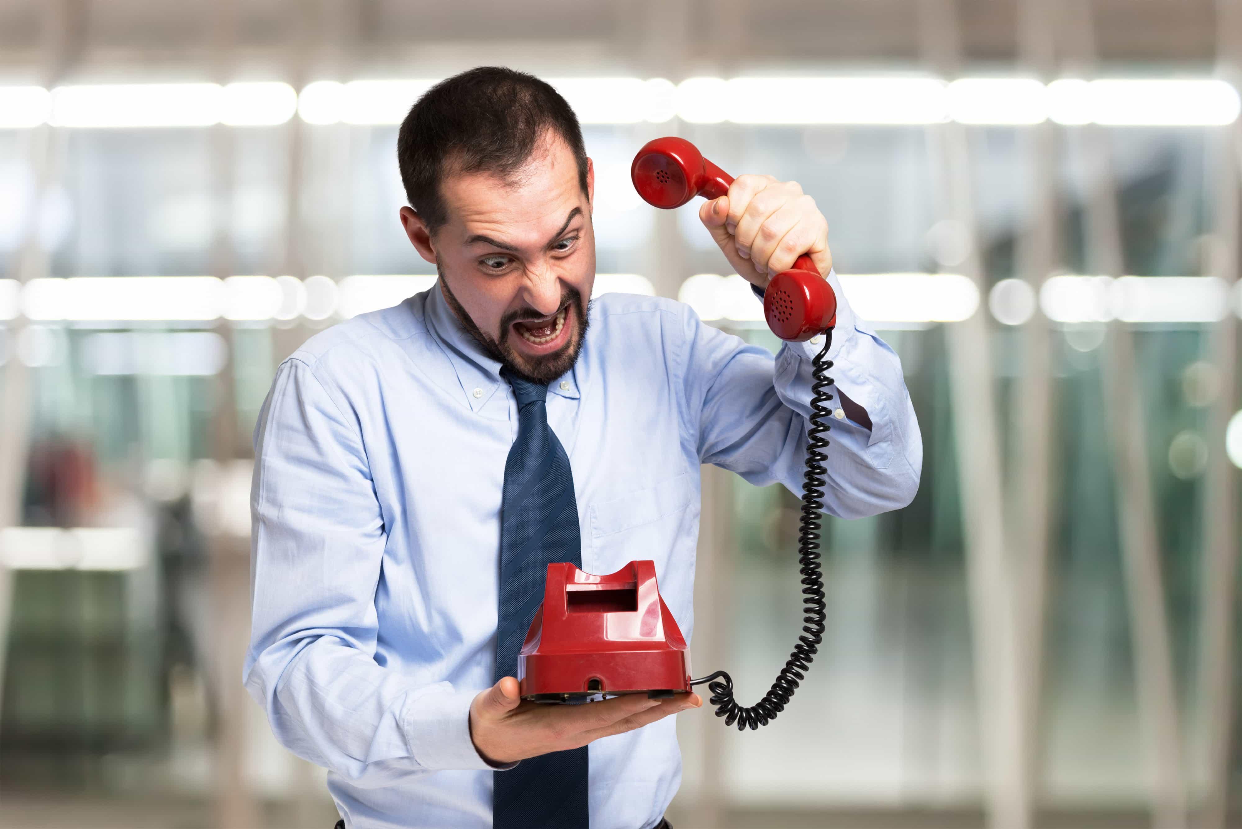 Angry man slamming the phone down