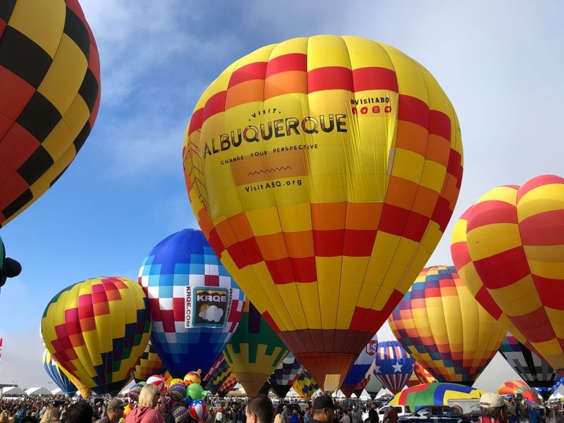 FILE - Hot air balloons are inflated during the annual Albuquerque International Balloon Fiesta in Albuquerque, N.M., on Saturday, Oct. 5, 2019. The Santa Fe Opera, Meow Wolf and the non-profit organization that puts on the Albuquerque International Balloon Fiesta are among the New Mexico businesses that received loans from the federal government as part of massive effort to support the economy amid the coronavirus outbreak. (AP Photo/Susan Montoya Bryan, file)