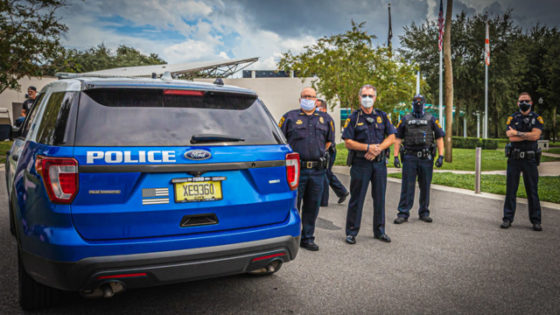 Police officers stand by during a protest in New Port Richey, Florida on Aug. 23, 2020.