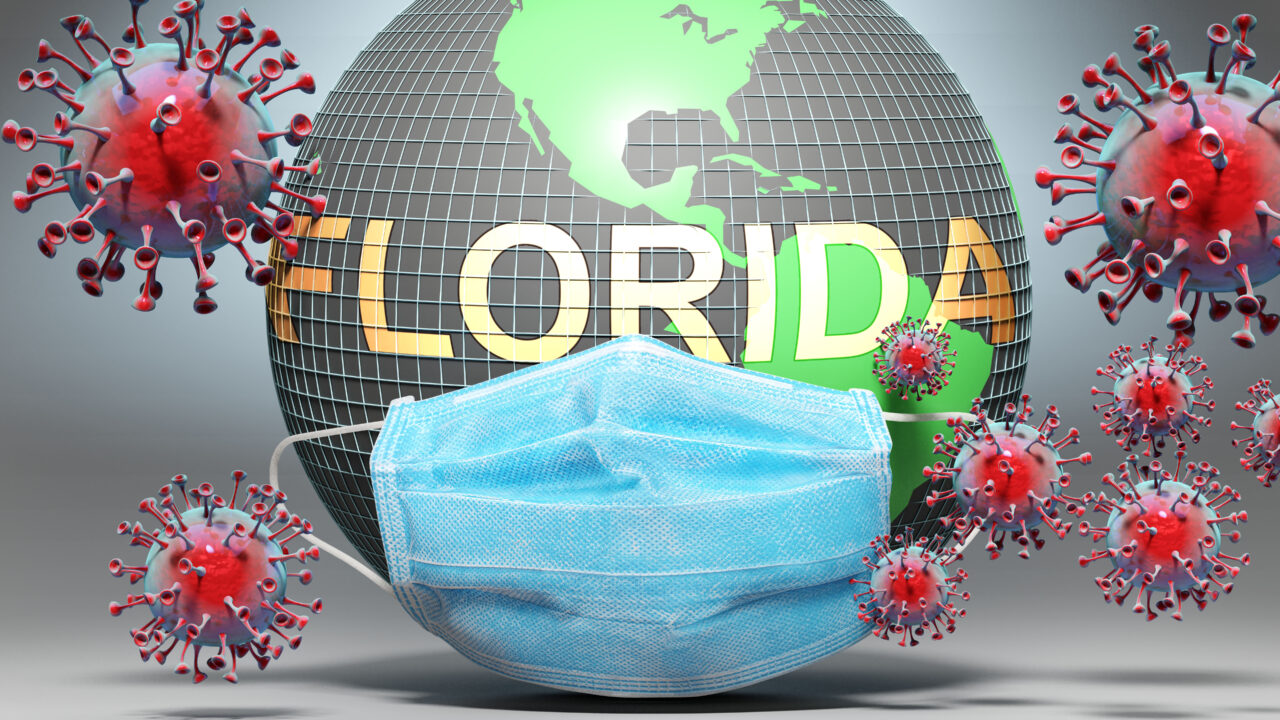 Florida and covid - Earth globe protected with a blue mask again