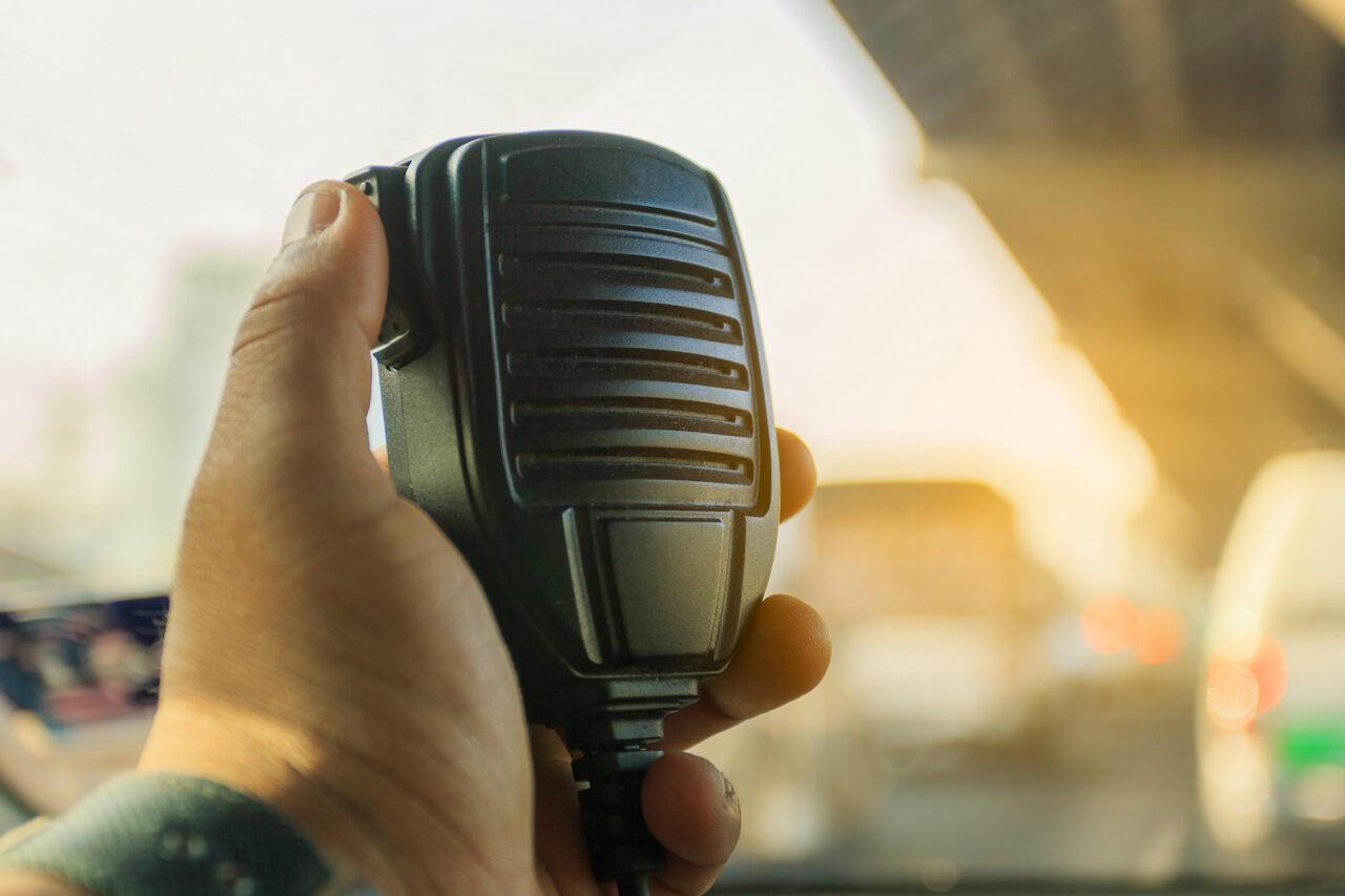 Radio communication service and emergency calls on traffic jam background.