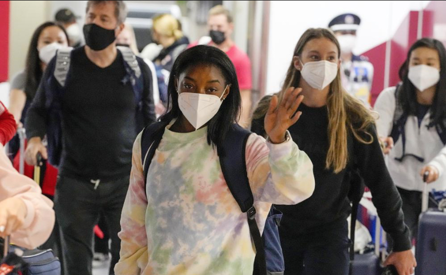 Simone-Biles-center-and-the-U.S.-Womens-Gymnastics-team-arrive-for-the-Tokyo-2020-Summer-Olympic-Games-at-Narita-International-Airport-Thursday-July-15-2021-in-Narita-east-of-Tokyo.-.jpg